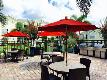 Tables with Umbrellas - Ashton Chase - Clermont, FL
