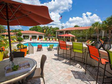 Poolside Tables - The Pavilions at Monterey - Palm Bay, FL