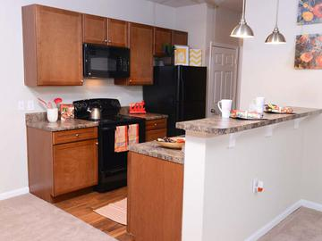 Kitchens with Breakfast Bars - Waterstone at Jenks - Panama City, FL